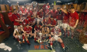 Wales's players celebrate in the dressing room after defeating Ireland to take the Six Nations grand slam.