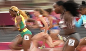 Elaine Thompson-Herah of Jamaica gets to the front of the field.