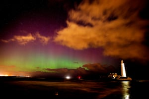 The northern lights illuminate the sky over St Mary's lighthouse near Whitley Bay
