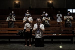 People attend a Eucharist at the Rio de Janeiro Metropolitan Cathedral in Rio de Janeiro, Brazil, on 4 July 2020.