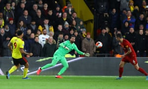 Troy Deeney of Watford scores his team's third goal past Liverpool keeper Alisson.