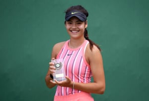 Raducanu poses with the trophy she received after victory in the British Tour women's final against Jodie Burrage in July 2020