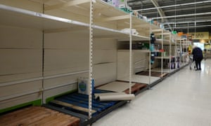 Near empty shelves of toilet paper stock at a supermarket in Llandudno, north Wales.