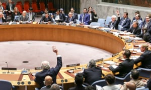 Vitaly Churkin, top, right, the Russian permanent representative to the United Nations, and Rafael Ramírez Carreno, lower, left, of Venezuela vote against a France-drafted UN security council resolution on Syria.