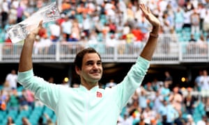 Roger Federer of Switzerland poses with the winners trophy after defeating John Isner in straight sets.