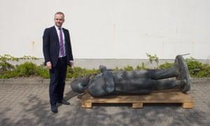 The Neubrandenburg mayor, Silvio Witt, with the city's statue of Marx