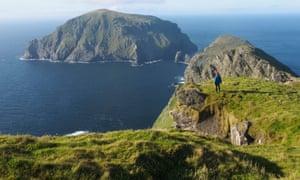 A walker on Hirta, St Kilda, looking towards Soay.