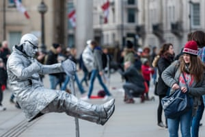 Living statues and tourists in Trafalgar Square.
