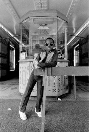 4. A Boy in Front of the Loews 125th Street Movie Theater Harlem NY (1976)
