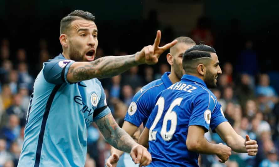 Manchester City's Nicolás Otamendi points out that the celebrating Riyad Mahrez has played the ball twice in taking Leicester City's penalty