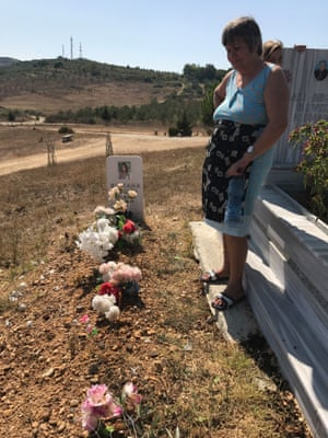 Silvana's mother, Yllka, at the grave of her daughter, close to the family farm in the Fier district of Albania