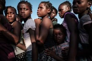 Children wait in line to receive food