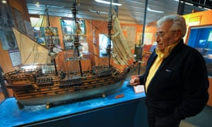 Treasure hunter Rubén Collado stands in front of a model of the British 64-cannon ship Lord Clive, sunk in 1763 under fire of the Spanish batteries, in Colonia del Sacramento, 188km west of Montevideo.