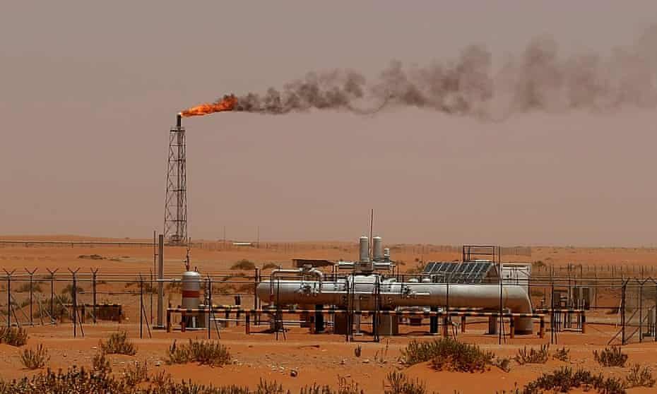 """A flame from a Saudi Aramco oil installion known as """"Pump 3"""" is seen in the desert near the oil-rich area of Khouris, 160 kms east of the Saudi capital Riyadh, on June 23, 2008."""