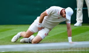Andy Murray holds his groin after a slip on the baseline.