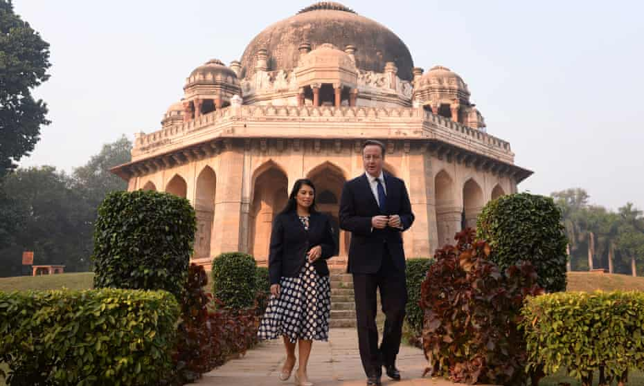 David Cameron and Priti Patel in front of the Shah Sayyid Tomb in the Lodi Gardens in Delhi, India.