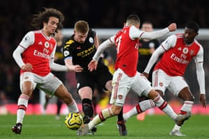 Manchester City's Belgian midfielder Kevin de Bruyne has three Arsenal players around him as he produces another phenomenal display, scoring twice as City beat Arsenal 3-0 on Sunday.