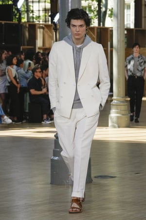 Officine Generale   Always to be relied upon for nailing insouciant French chic, Officine Generale didn't disappoint on the see-now, want-to-buy now stakes. Limited to a beautifully pared-back palette of navy, white, tan and teal, the tried-and-tested uniform of jeans, shirt and blazer somehow looked fresher than ever before. The high-low mix synonymous with the French capital was also alluring: blazers were styled with cotton jumpsuits, suits were worn with hoodies and sneakers, and denim jeans with a tonal shirt and tie. A series of suits in sugary pink were delicious.