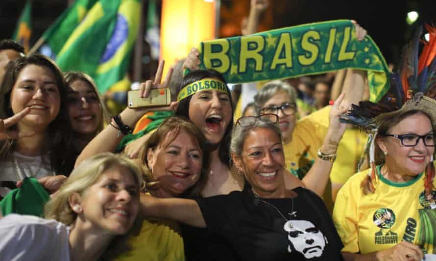 Supporters of Jair Bolsonaro celebrate in front of the National Congress in Brasilia.