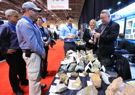 Visitors look at ore samples during the 2016 PDAC International Convention in Toronto.