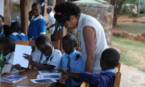 Sorting out the photos at the Kids Twiga Tally. The photo shows Paula Kahumbu with children who participated in the event.