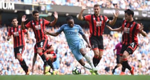 Manchester City's Raheem Sterling wriggles past Bournemouth's Andrew Surman and Simon Francis