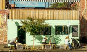 Diners sit outside a cafe in Melbourne's Richmond district.