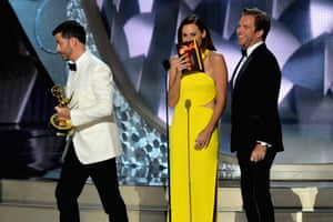 Host Jimmy Kimmel, actress Minnie Driver and actor Michael Weatherly onstage