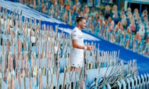 Jack Harrison celebrates Leeds's third goal in the empty Elland Road stands.