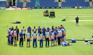 England players break from training to observe a minute's silence at the Swalec stadium in Cardiff.