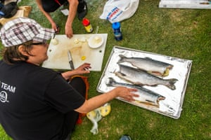 Each day traditional foods were cooked and served to the Elders. Here sockeye salmon is being prepared for cooking.