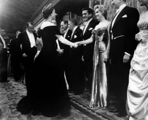 A young Queen Elizabeth II shakes hands with Marilyn Monroe before the Royal Command Performance of the film Battle of the River Plate in October 1956