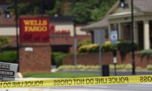 Police tape blocks the entrance to a Wells Fargo Bank in Marietta, Georgia Friday.