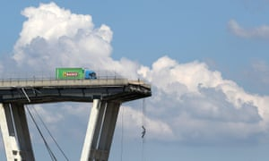 A lorry that managed to stop in time when a section of the Morandi bridge collapsed in Genoa.