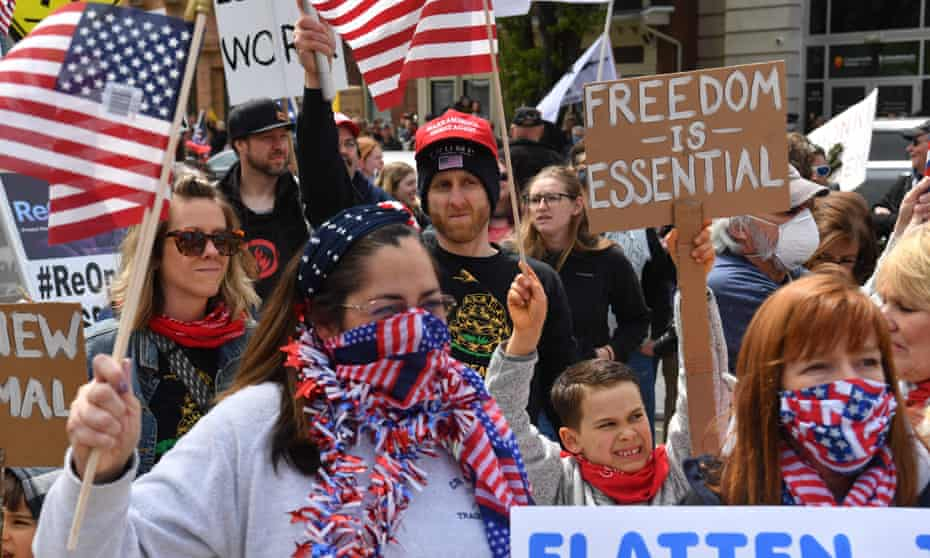 People take part in a 'reopen' Pennsylvania demonstration in Harrisburg, Pennsylvania, on 20 April.