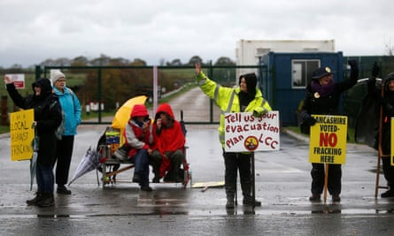 Protesters stand outside Cuadrilla's Preston New Road fracking site near Blackpool, yesterday.