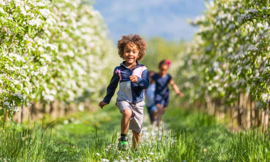 Children running through fields