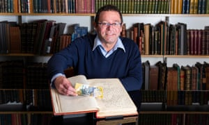 Ronald Briggs, the State Library of NSW's Indigenous Curator, with David Unaipon's original manuscript and a $50 note