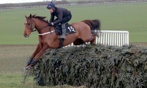 Definitly Red, seen here jumping the Aintree fence on the Malton Gallops, was a strong winner at Doncaster on Saturday.
