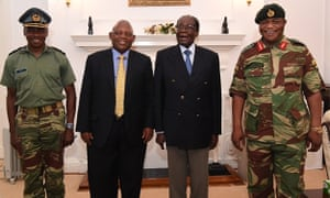 President Robert Mugabe (2R) poses alongside Zimbabwe Defence Forces Commander General Constantino Chiwenga (R) and South African envoys at State House in Harare.