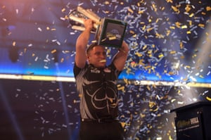 Gerwyn Price celebrates with the trophy after winning the World Darts Championship.