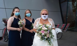 A bride wears a Mr & Mrs face mask on her wedding day outside Slough Registry Office. Slough in Berkshire has been named by Public Health England and the Department for Health and Social Care as a Covid-19 'area of concern' following a recent increase in the number of cases.