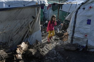Lesbos, Greece. A girl walks on a muddy path in a makeshift camp next to the overcrowded Moria refugee camp near the capital, Mytilene