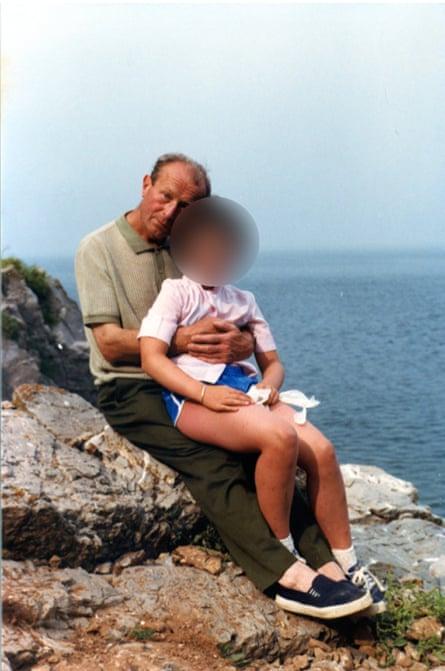 Father Thaddeus Kotik with a child