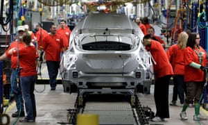 In a 2012 photo, Ford Focus vehicles are assembled in Wayne, Michigan.