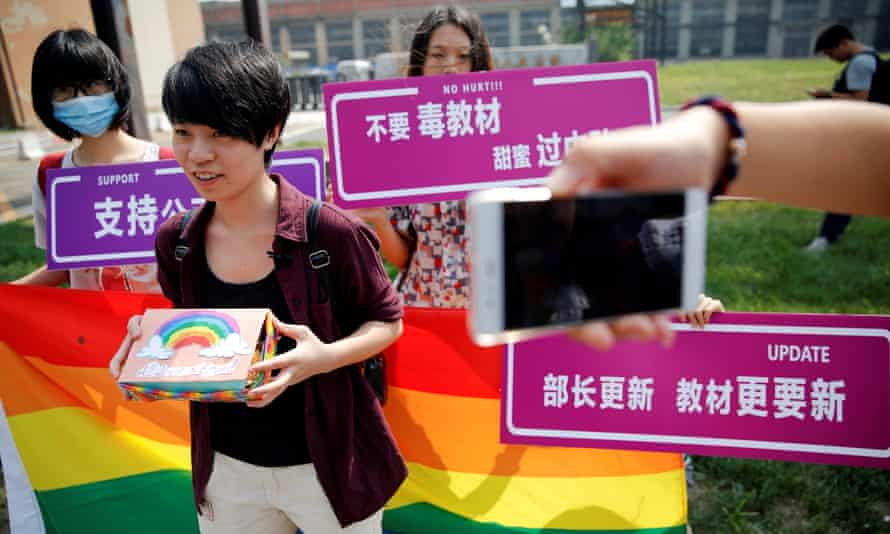 Qiu Bai with gay rights campaigners outside the court in Beijing.