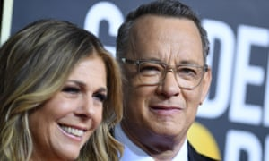 In this file photo US actor Tom Hanks and wife Rita Wilson arrive for the 77th annual Golden Globe Awards on January 5, 2020, at The Beverly Hilton hotel in Beverly Hills, California.
