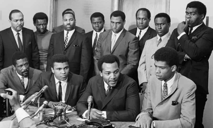 Kareem Abdul-Jabbar (front right) attends the Cleveland Summit alongside other prominent black athletes, such as Muhammad Ali, in 1967