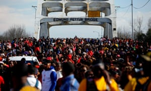People march during the annual Bloody Sunday March across the Edmund Pettus Bridge in Selma