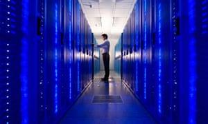 An IT technician checks a network server.